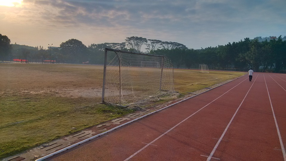 athletic track, sunrise, playground