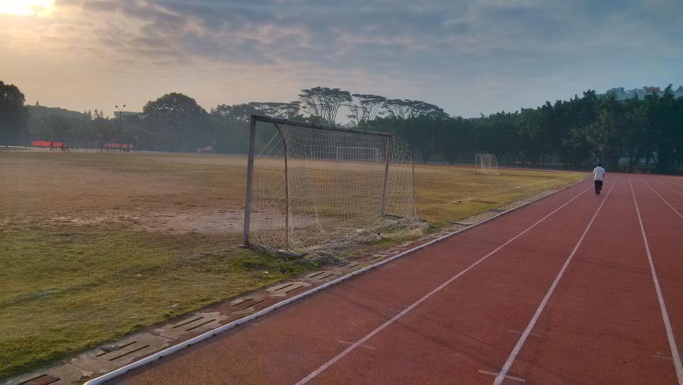 athletic track, sunrise, playground