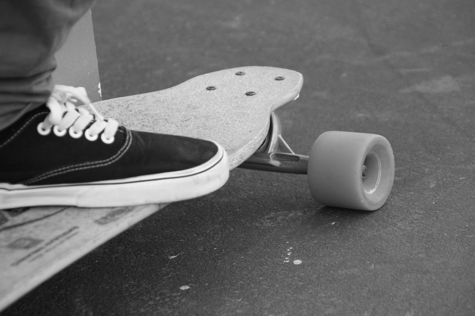 skateboard, black and white, table