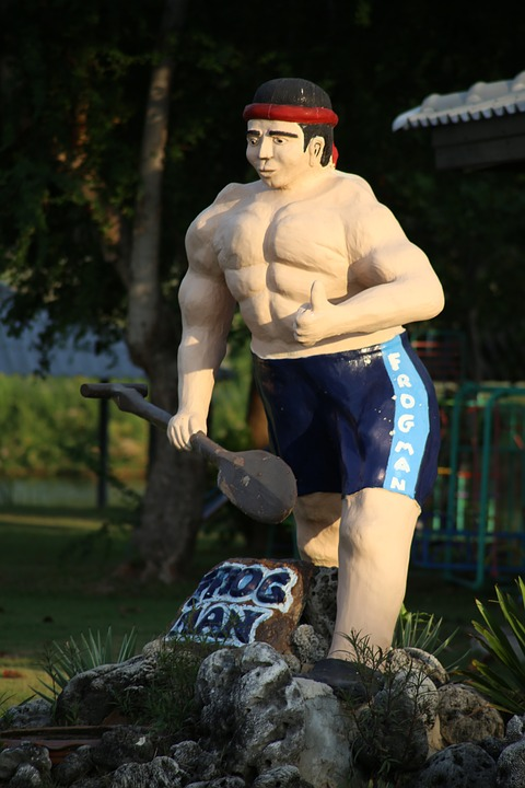 the statue, muscle, tourist attraction