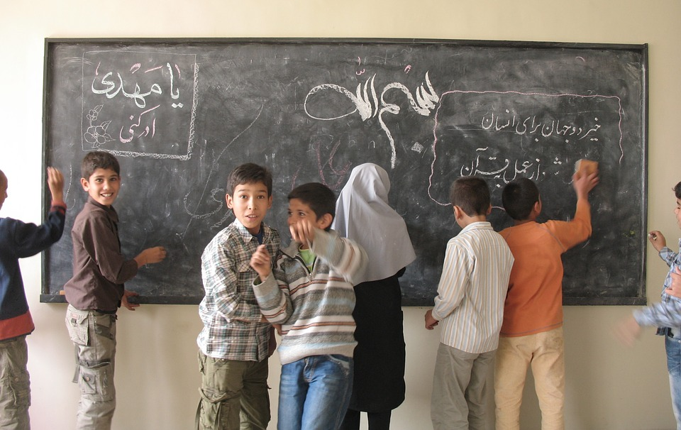students, chalkboard, village