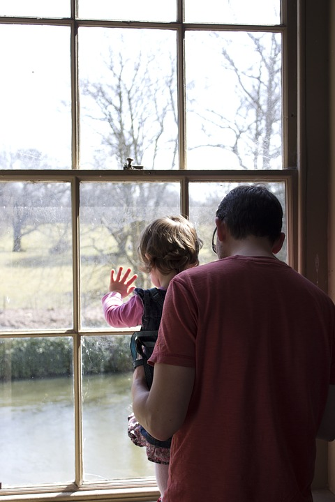 father, daughter, window