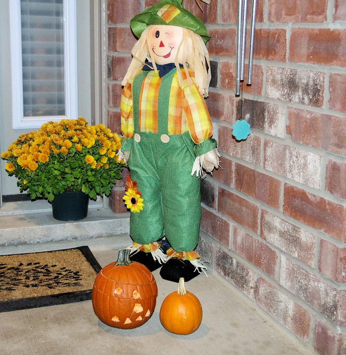 halloween doll, pumpkin lantern, flowers