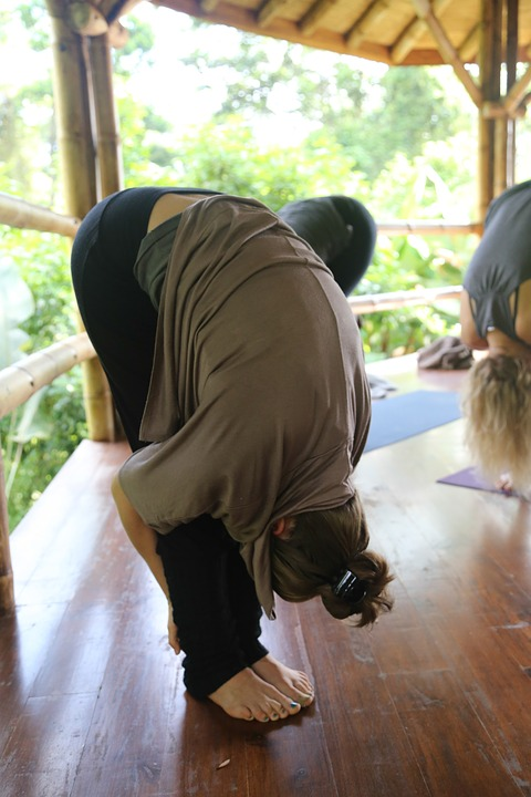 yoga, forward fold, costa rica
